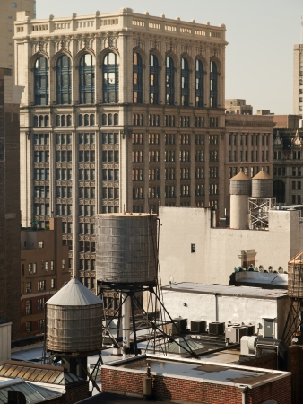 Water Tanks on Top of New York City Roofs Stock Photo