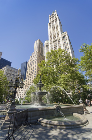 The Fountain of the City Hall  Park and Woolworth Building, in New York