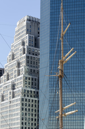 The Mast of a Vessel Contrasts with the Skyscrapers of New York