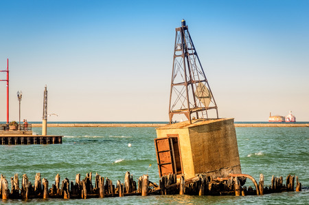 Old concrete buoy on breakwater in Chicago