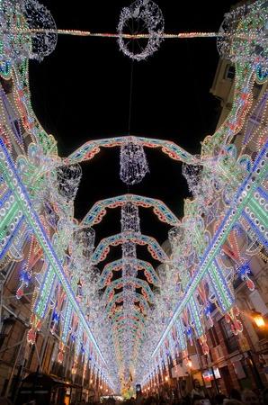VALENCIA, SPAIN - MARCH 17: The streets of Valencia are richly illuminated for the Fallas festival, March 17, 2013 in Valencia, Spain
