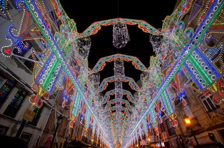 VALENCIA, SPAIN - MARCH 17: The streets of Valencia are richly illuminated for the Fallas festival, March 17, 2013 in Valencia, Spain