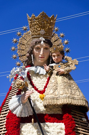A Huge Figure of Our Lady of the Forsaken is decorated with Flowers during the Fallas Festival in Valencia