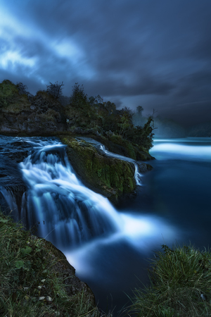 The second biggest cascade of Europe called the Rhine Falls taken during the night with moonlight.