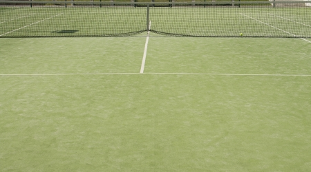 Empty green tennis  field with white marks photo