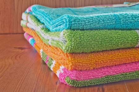 Towels from different colors ready to be used photo