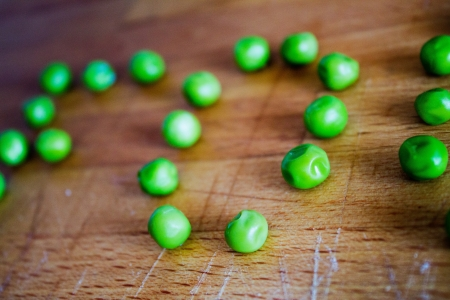 Macro from peas on a wood table