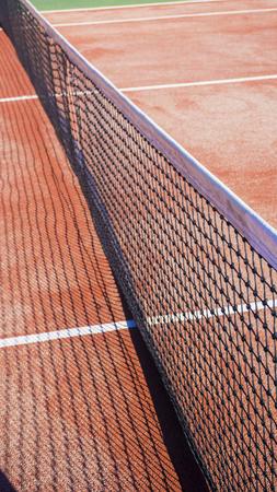 tennis clay: Tennis net on a tennis clay court Stock Photo