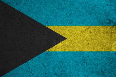 bahamas flag on an old grunge background Stock Photo