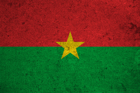 national identity: burkina faso flag on an old grunge background