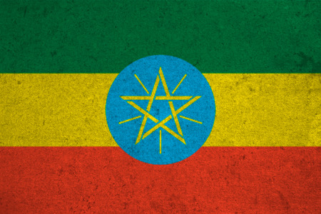 ethiopia abstract: ethiopia flag on an old grunge background Stock Photo
