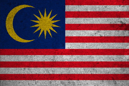 Malaysia flag on an old grunge background