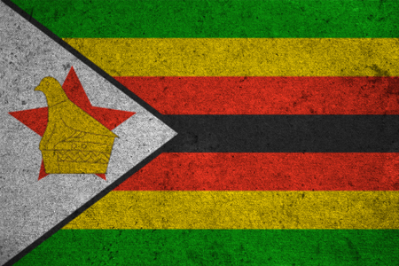 national identity: Zimbabwe flag on an old grunge background