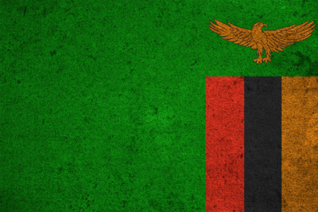 zambia flag: Zambia flag on an old grunge background Stock Photo