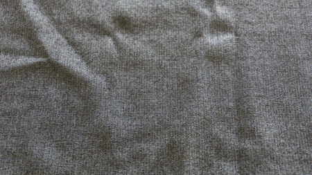 Macro from textile jersey made from black and grey cotton Foto de archivo - 100549603