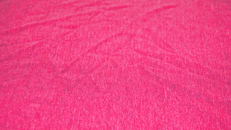 Detailed picture of jersey made from linen in pink color Foto de archivo - 117135559