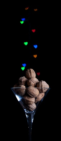 Glass of  walnut with heart bokeh Stock Photo