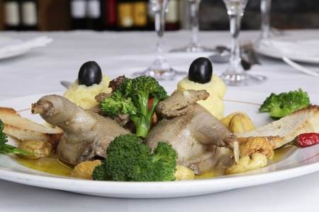 Restaurant dish - partridge stuffed with chestnuts photo
