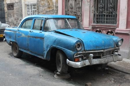 wrecked: Wrecked old car in La Havana in Cuba Editorial