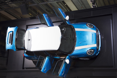 car with open trunk from above photo