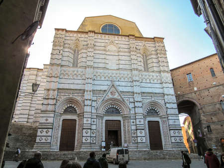 Sienna, Italy, February 26, 2019: Main facade of the Baptistery of San Juan of Sienna Editoriali