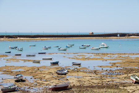 low tide with boats shored 2 Stock Photo