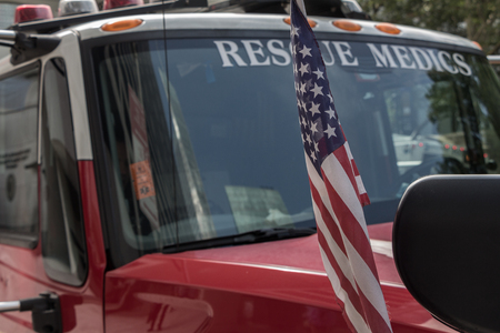New York - July 15, 2017: Parked rescue medic truck with a USA flag in the streets of Manhattan of New York City