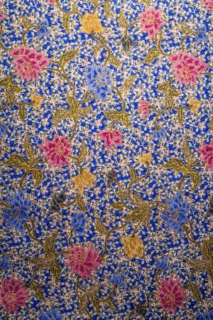 Colorful flower pattern on batik fabric bacground photo