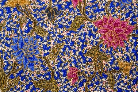 Flower and leaf batik pattern on blue bacground photo