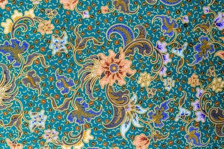 close knit: Orange flower pattern on blue fabric background