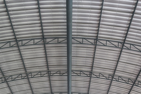 modular home: Close up metal truss of roof structure