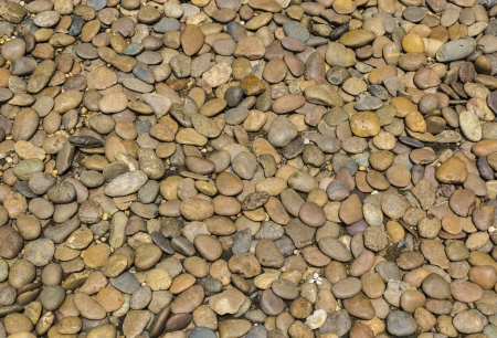 Closeup pile of pebble stone background photo