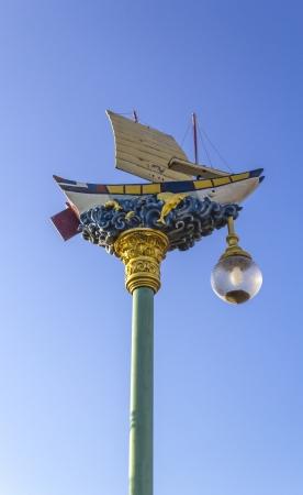 Street light lamp on the blue sky background