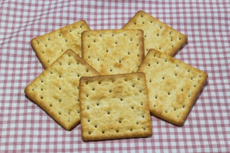 Closeup stack of square cracker on tablecloth