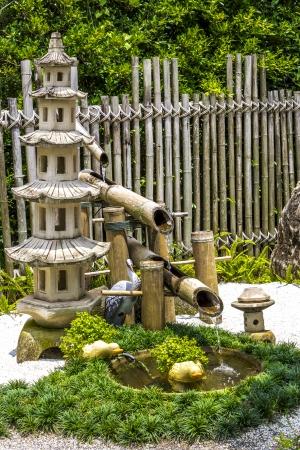 bamboo fountain: Pagada stone and  bamboo fountain in japanese garden Stock Photo