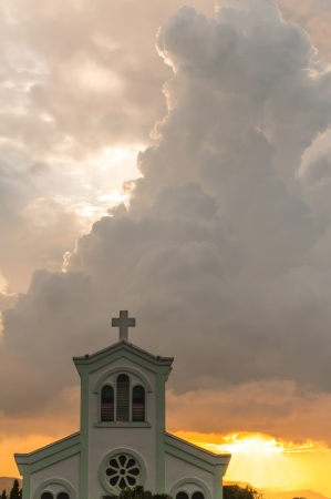 christus: Classical church with sunset and orange clouds background Stock Photo