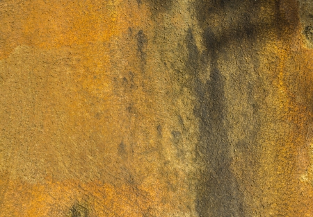 Grunge stained of yellow concrete wall background