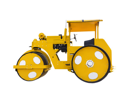 Ancient road roller isolated on white background with clipping path photo