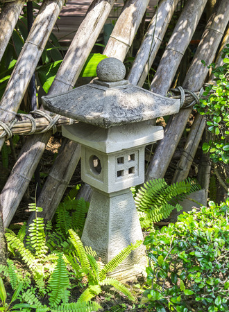 Closeup traditional japanese stone lantern in garden photo