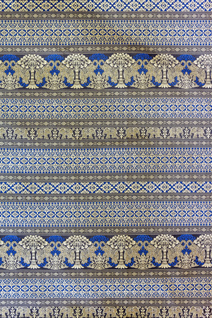 Closeup pattern of elephant and tree on thai silk fabric