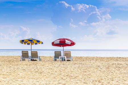 Beach chair and umbrella on tropical sand beach photo