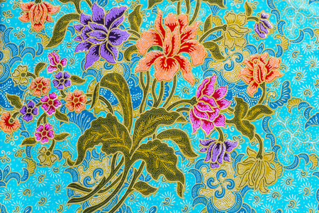 Beautiful colorful flowers pattern on batik background Stock Photo
