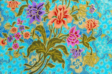 Beautiful colorful flowers pattern on batik background Stock Photo
