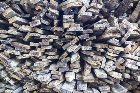Closeup stack of old wooden bars background photo