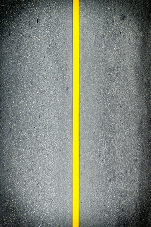 Closeup yellow center line on road background Stock Photo