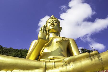 buddah: Big gloden Buddah statue with blue sky background Stock Photo