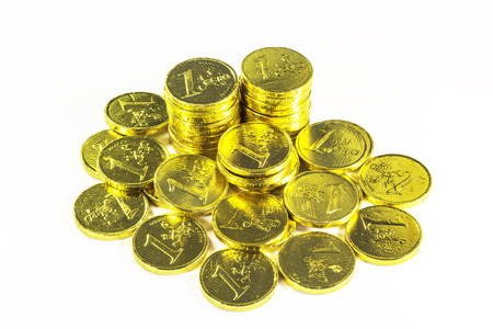 Stack of golden coins on white background
