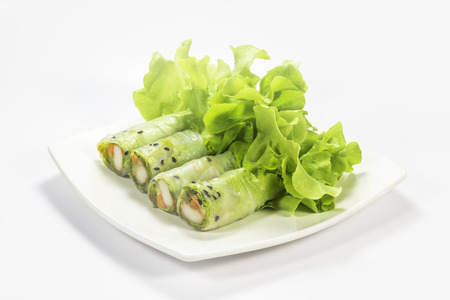 Salad roll with vegetables on the plate