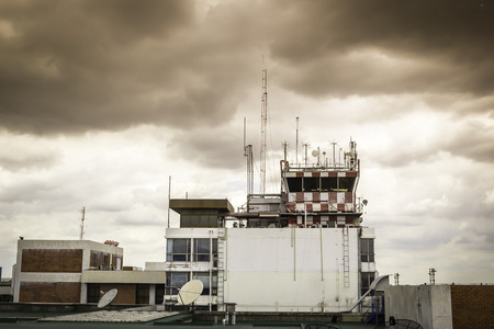 control tower: Building of Flight control tower with clouds Stock Photo