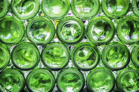 Closeup bottoms of green color bottles background Stock Photo